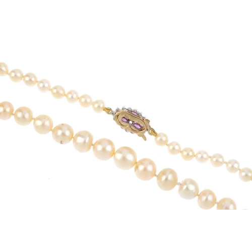 126 - A 9ct gold single-strand cultured pearl necklace. Comprising of sixty-seven slightly graduated cultu...