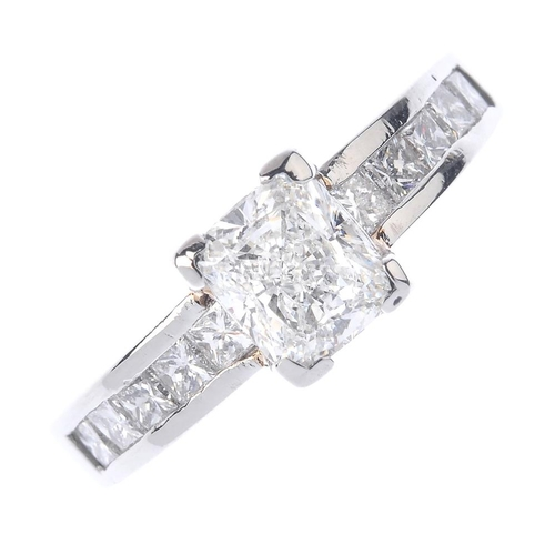 1260 - (546732-4-A) A platinum diamond dress ring. The cushion-cut diamond weighing 1.02cts, with square-sh...