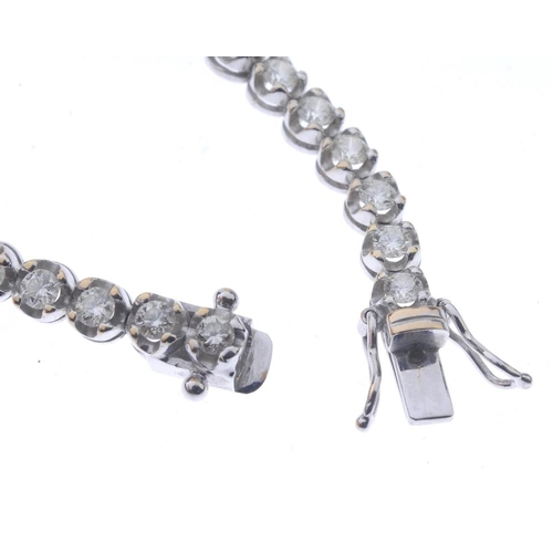 1261 - (546799-1-A) A diamond line bracelet. Designed as a series of thirty-eight brilliant-cut diamonds, w...