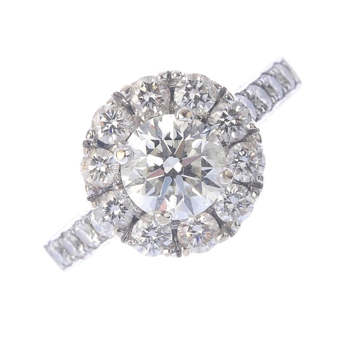 1262 - (546800-1-A) A diamond cluster ring. The brilliant-cut diamond, with a similarly-cut diamond surroun...