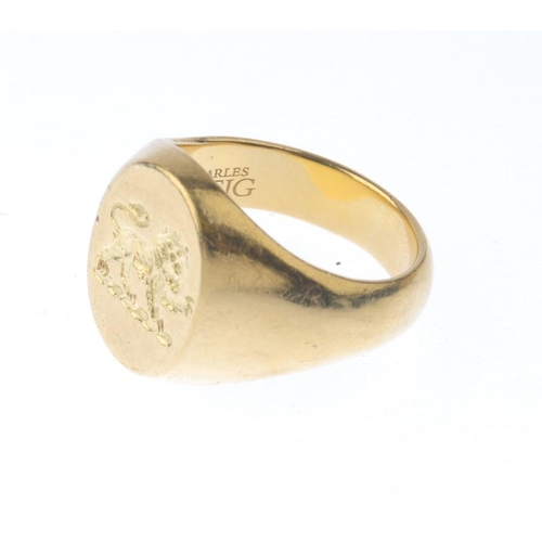 1263 - (546914-1-A) A gentleman's signet ring. The oval-shape panel, depicting a lion, with tapered shoulde...