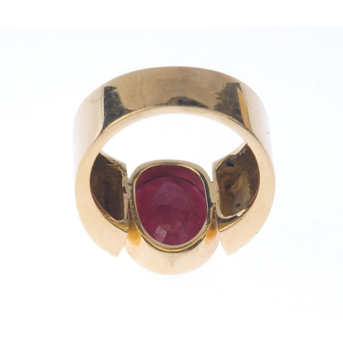 1266 - (546960-1-A) A glass-filled ruby single-stone ring. Designed as an oval-shape glass filled ruby coll...