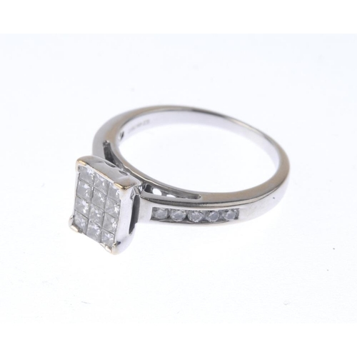 1268 - (546976-1-A) An 18ct gold diamond dress ring. The square-shape diamonds, within a rectangular-shape ...