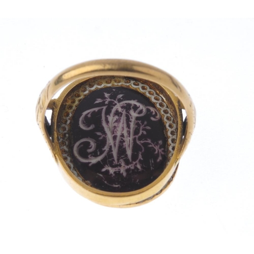 1269 - (547000-1-A) A Late Georgian ring. Designed as an oval-shape Late Georgian plague Tudor revival plaq...