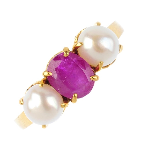 127 - A ruby and cultured pearl three-stone ring. The oval-shape ruby, with cultured pearl sides and openw...