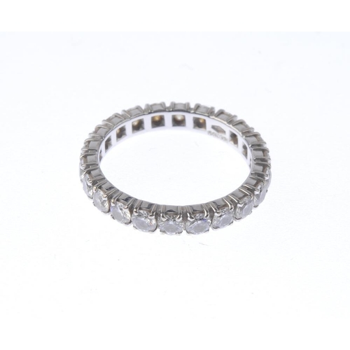 1280 - (547485-1-A) A diamond full circle eternity ring. Designed as a series of brilliant-cut diamonds. Es...
