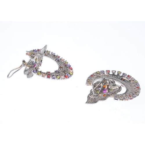 1282 - (547510-2-A) A pair of cubic zirconia and gem-set earrings. Each designed as a multi-gem cluster, wi...