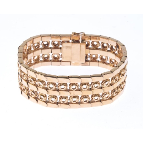 1288 - (203799) A diamond bangle. Of openwork design, to the concealed push-piece clasp. Length 19cms. Weig...