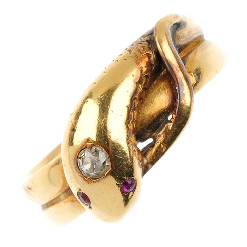 129 - An Edwardian 18ct gold diamond and gem-set snake ring. Designed as a coiled snake, with old-cut diam...