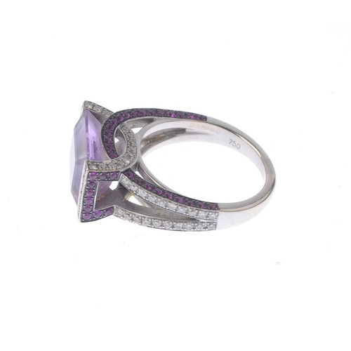 1290 - (547968-5-A) GARRARD - an amethyst, diamond and ruby dress ring. The rectangular-shape amethyst, wit...