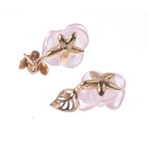 1297 - (548057-1-A) DIOR - a pair of rose quartz and diamond earrings. Each designed as a carved rose-quart...