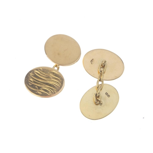 1298 - (548112-1-A) Two pairs of 18ct gold cufflinks. To include one pair each designed as a flaming grenad...