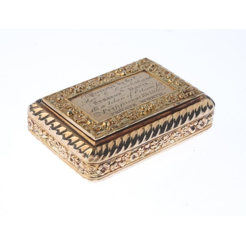 1299 - (548112-2-A) A Georgian silver gilt snuff box. Of rectangular outline, the spiral-grooved sides with...