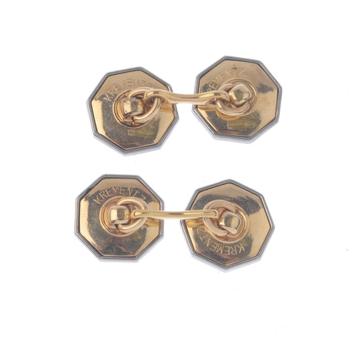 1300 - (548126-1-A) A pair of mid 20th century mother-of-pearl cufflinks and dress studs. Each cufflink des...
