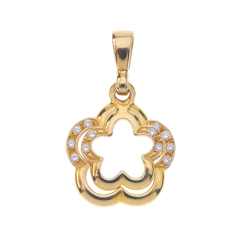 1301 - (548126-2-A) A diamond pendant. Comprising two graduated stylised flowers, each with brilliant-cut d...