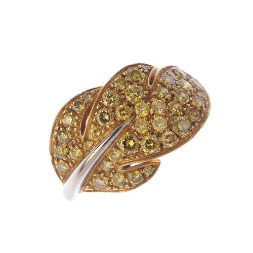 1302 - (548259-1-A) A colour treated diamond foliate dress ring. The pave-set colour treated 'yellow' leaf,...