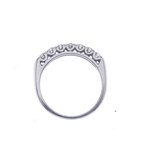 1304 - (548380-1-A) 7 A diamond half-circle eternity ring. The brilliant-cut diamond line, with tapered ban...