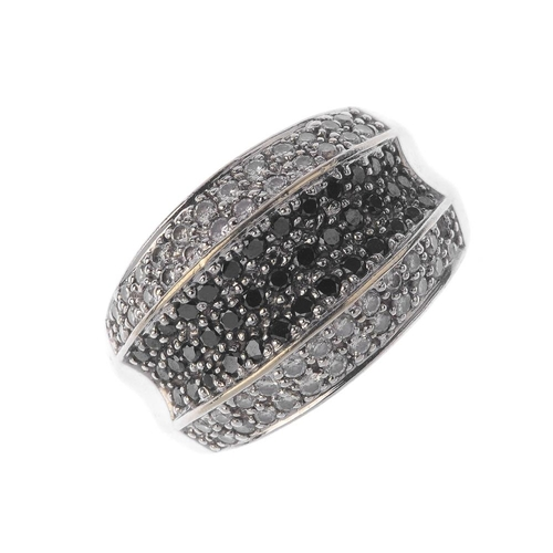 1305 - (548428-1-A) A diamond and gem-set ring. The pave-set black gem curved panel, with pave-set diamond ...