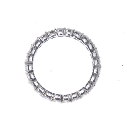 1306 - (549308-1-A) A diamond full-circle eternity ring. Comprising a brilliant-cut diamond line. Estimated...