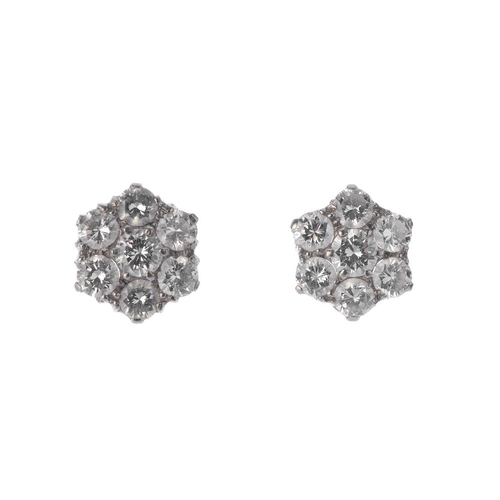 1311 - (549402-1-A) A pair of diamond cluster earrings. Each designed as a brilliant-cut diamond, with simi...