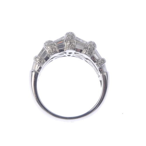 1316 - (550198-4-A) A diamond dress ring. The baguette-cut diamond line, with pave-set diamond line spacers...