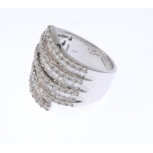 1317 - (550198-5-A) A diamond dress ring. Of crossover design, the alternating baguette and brilliant-cut d...