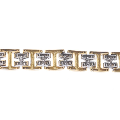 1319 - (550198-7-A) A diamond bracelet. Of bi-colour design, the alternating pave-set diamond and polished ...