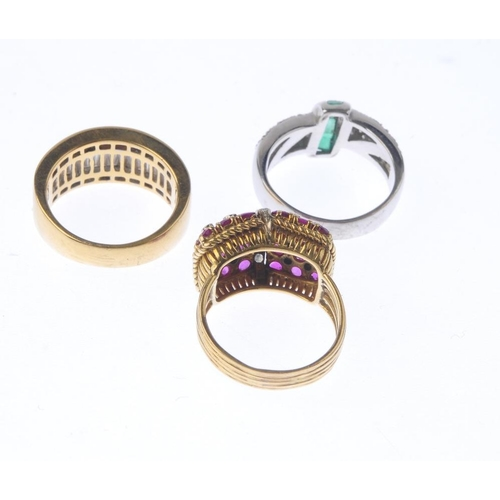 1322 - (550199-3-A) Three diamond and gem-set dress rings. To include a diamond band ring, an emerald and d...