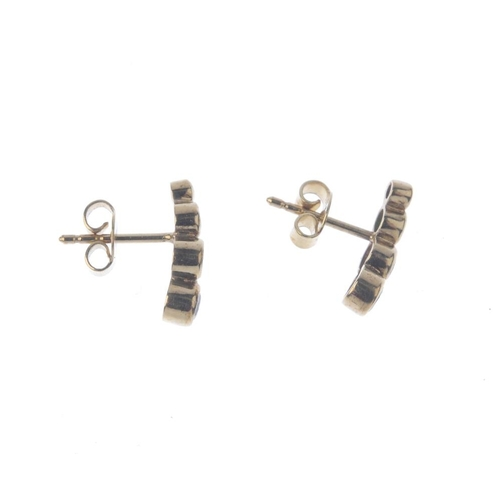 1324 - (550208-1-A) A selection of jewellery. To include a pair of diamond, emerald, ruby and sapphire stud...