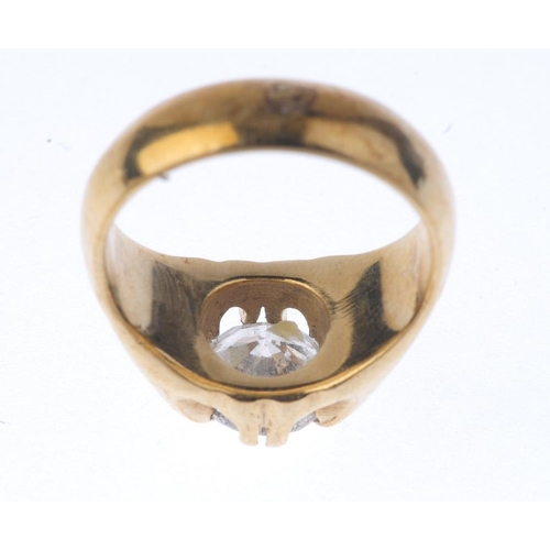 1325 - (550257-1-A) A 9ct gold diamond single-stone ring. The brilliant-cut diamond, with grooved tapered s...