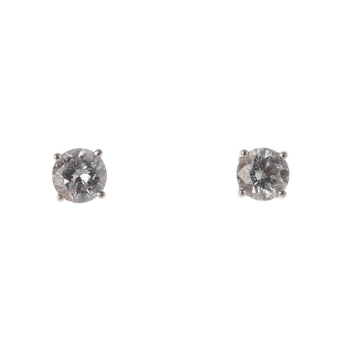1328 - (550411-1-A) A pair of brilliant-cut diamond stud earrings. Estimated total diamond weight 1ct, K-L ...