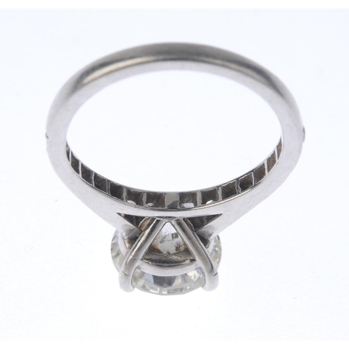 1329 - (550411-2-A) A platinum diamond single-stone ring. The brilliant-cut diamond, with similarly-cut dia...