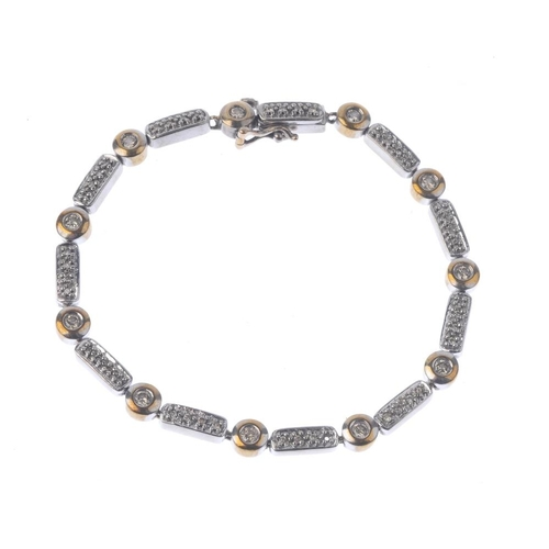 1332 - (550463-3-A) A 9ct gold diamond bracelet. Of bi-colour design, the brilliant-cut diamond bar links, ...