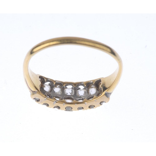 1334 - (550493-1-A) A late Victorian gold diamond ring. Comprising two old-cut diamond rows, with grooved s...