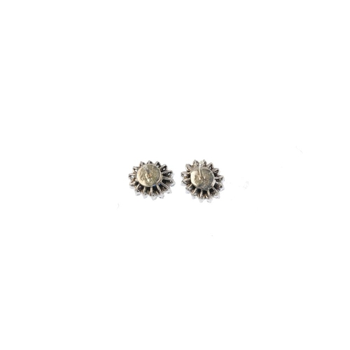 134 - A pair of sapphire and diamond cluster earrings. Each designed as an oval-shape sapphire, with singl...