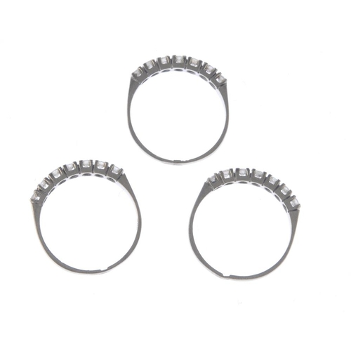 1345 - (7000808-1-A) Three diamond half-circle eternity rings. Each designed as a brilliant-cut diamond lin...