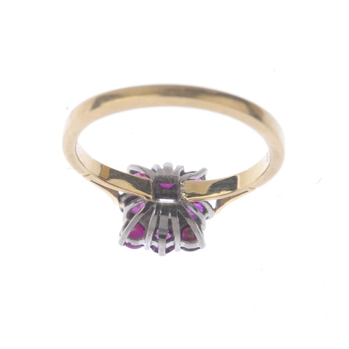 1349 - (7000808-5-A) An 18ct gold diamond and ruby cluster ring. The square-shape diamond, with circular-sh...