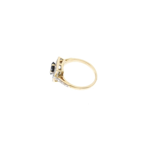 135 - An 18ct gold sapphire and diamond cluster ring. The square-shape sapphire, within a brilliant-cut di...