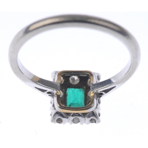 1350 - (7000808-6-A) An emerald and diamond cluster ring. The rectangular-shape emerald, with brilliant-cut...