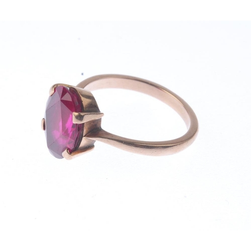 1352 - (7000808-8-A) A mid 20th century 9ct gold synthetic ruby single-stone ring. The oval-shape synthetic...
