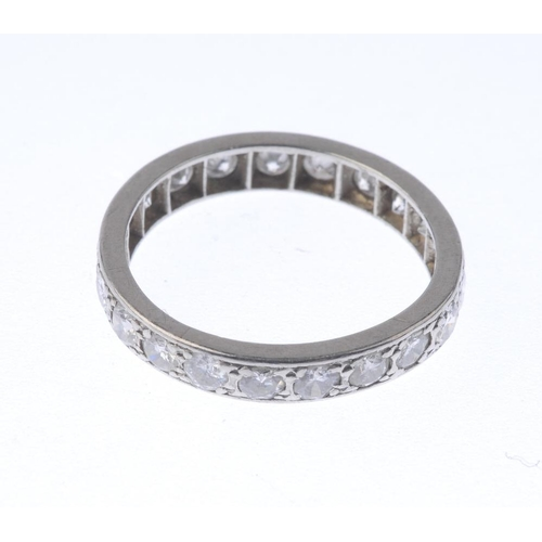 1353 - (7000809-3-A) A diamond full-circle eternity ring. Comprising an old-cut diamond line. Estimated tot...