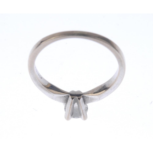 1355 - (9000384-1-A) A diamond single-stone ring. The brilliant-cut diamond, with tapered shoulders. Estima...