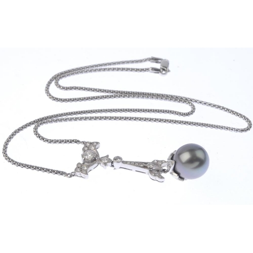 1358 - (203432) A cultured pearl and diamond necklace. The cultured pearl, with brilliant-cut diamond accen...