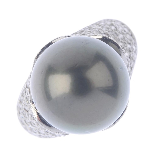 1359 - (203432) A dyed cultured pearl and diamond dress ring. The dyed cultured pearl, with a pave-set diam...