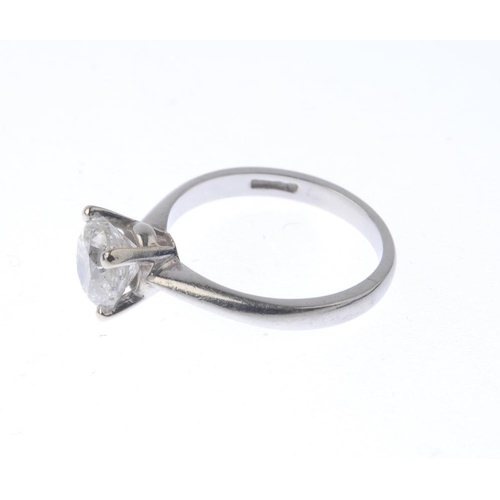 1360 - (203330) A platinum diamond single-stone ring. The brilliant-cut diamond, with plain band. Estimated...