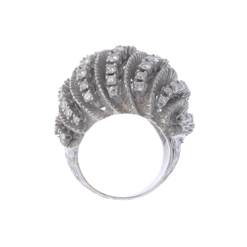 1362 - (198676) A mid 20th century diamond bombe ring. Designed as a series of brilliant-cut diamond curved...