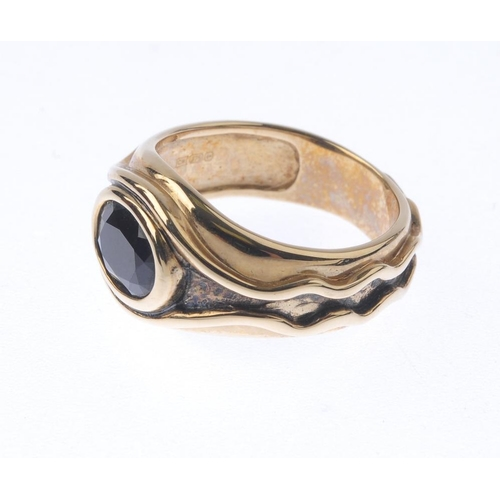 1367 - (133741) A 'Lord of the Rings' sapphire ring and pendant. To include a 9ct gold oval-shape sapphire ...