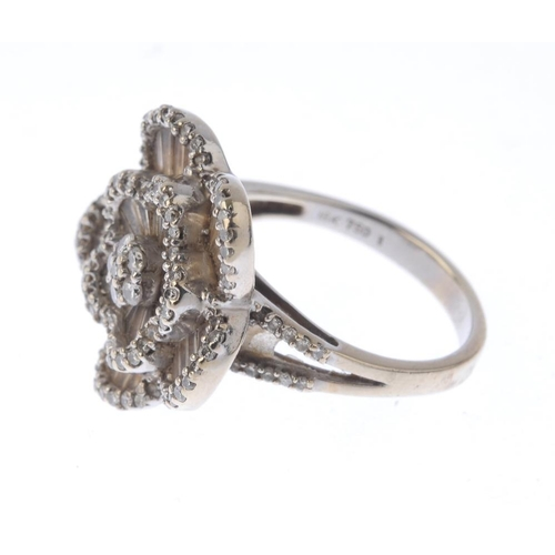 1369 - (133741) A diamond floral dress ring. Designed as a brilliant and baguette-cut diamond flower with b...