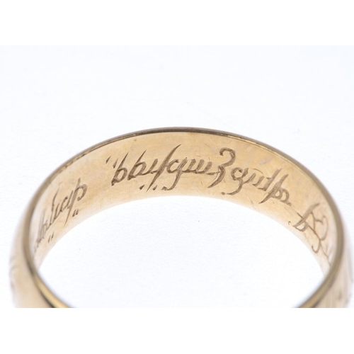 1371 - (133741) A 9ct gold 'Lord of the Rings' band ring. With inscription detail. Hallmarks for Birmingham...