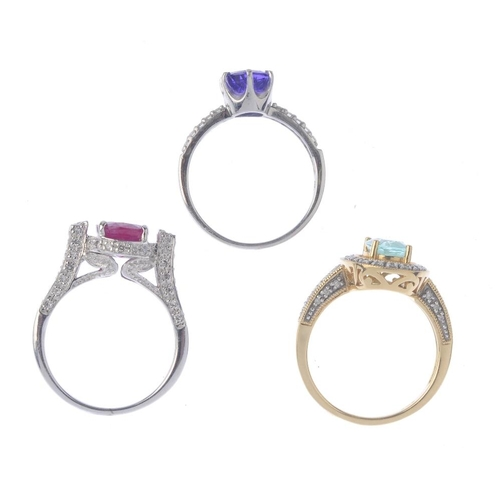 1373 - (133741) Three gold gem-set and diamond dress rings. To include a tanzanite and diamond dress ring, ...